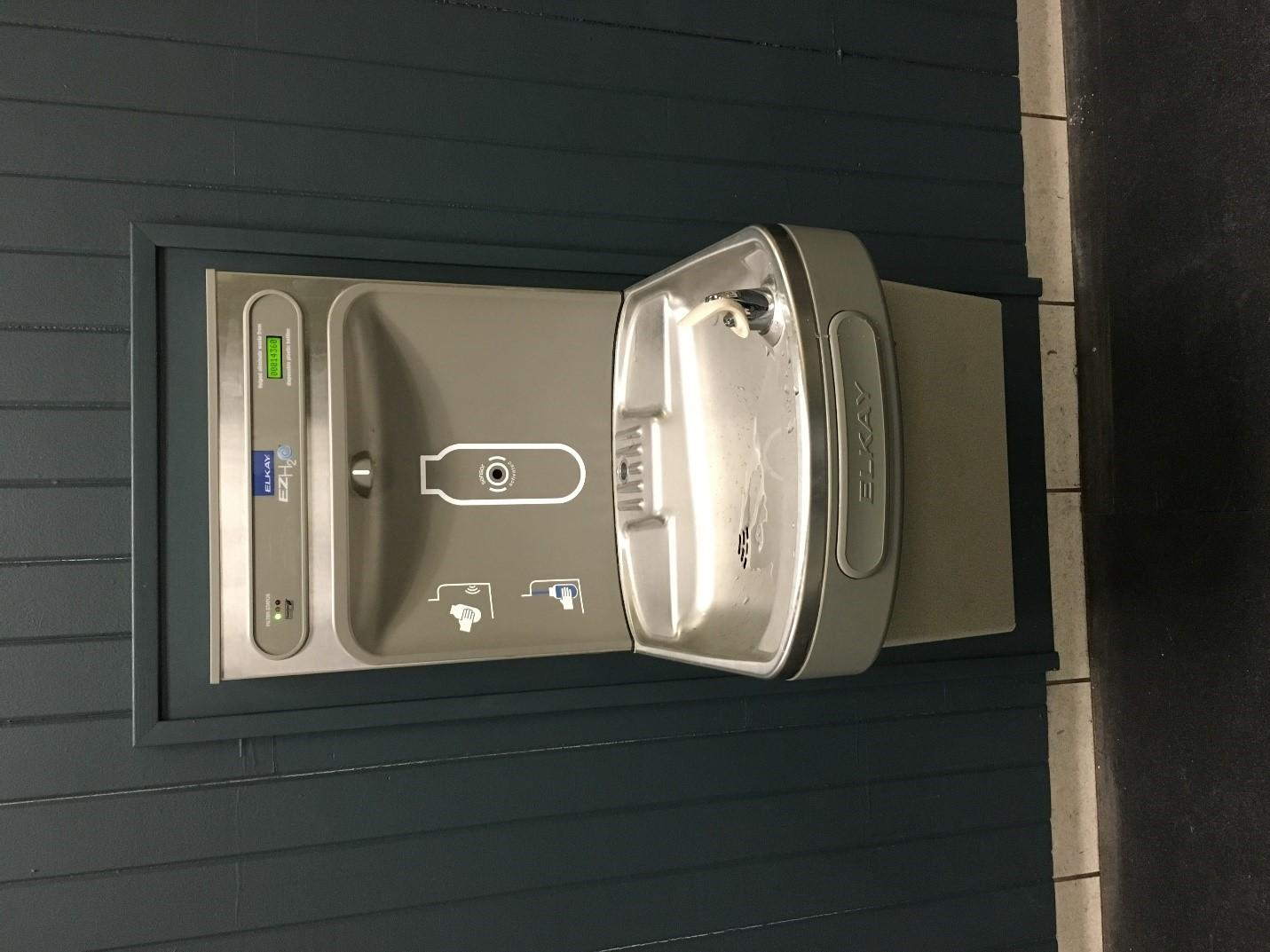 a new elkay water fountain with a green filter status in lossone rink courtesy of