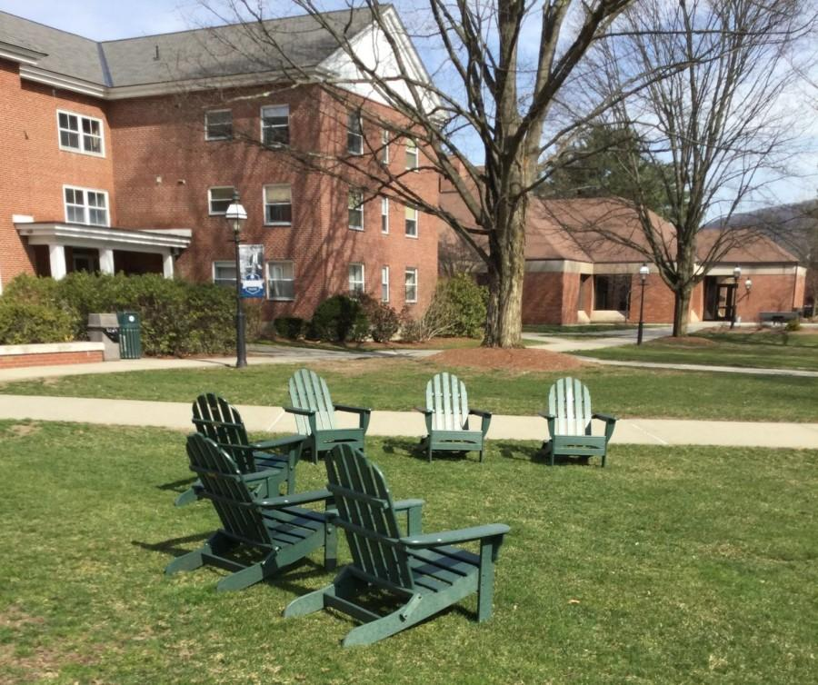 The green lawn chairs after being placed on the lawn of Memorial Hall.