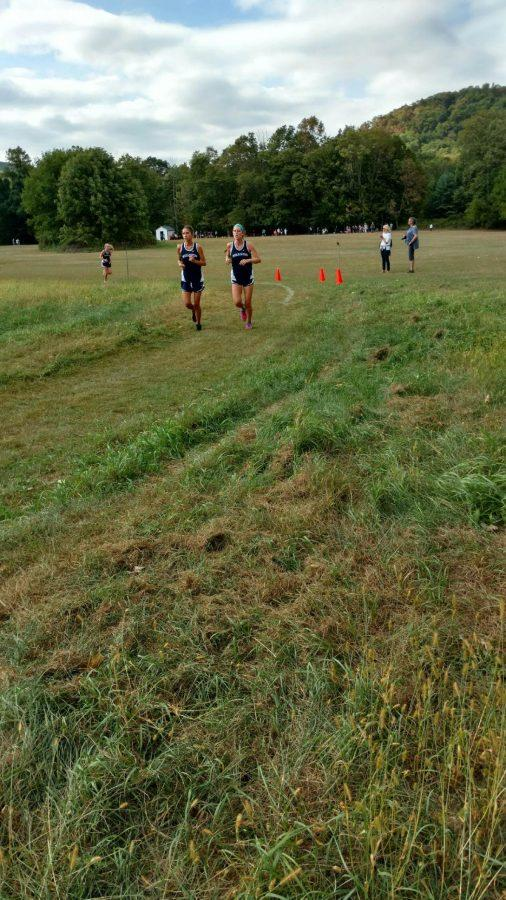 The girls cross country team running on their home course.
