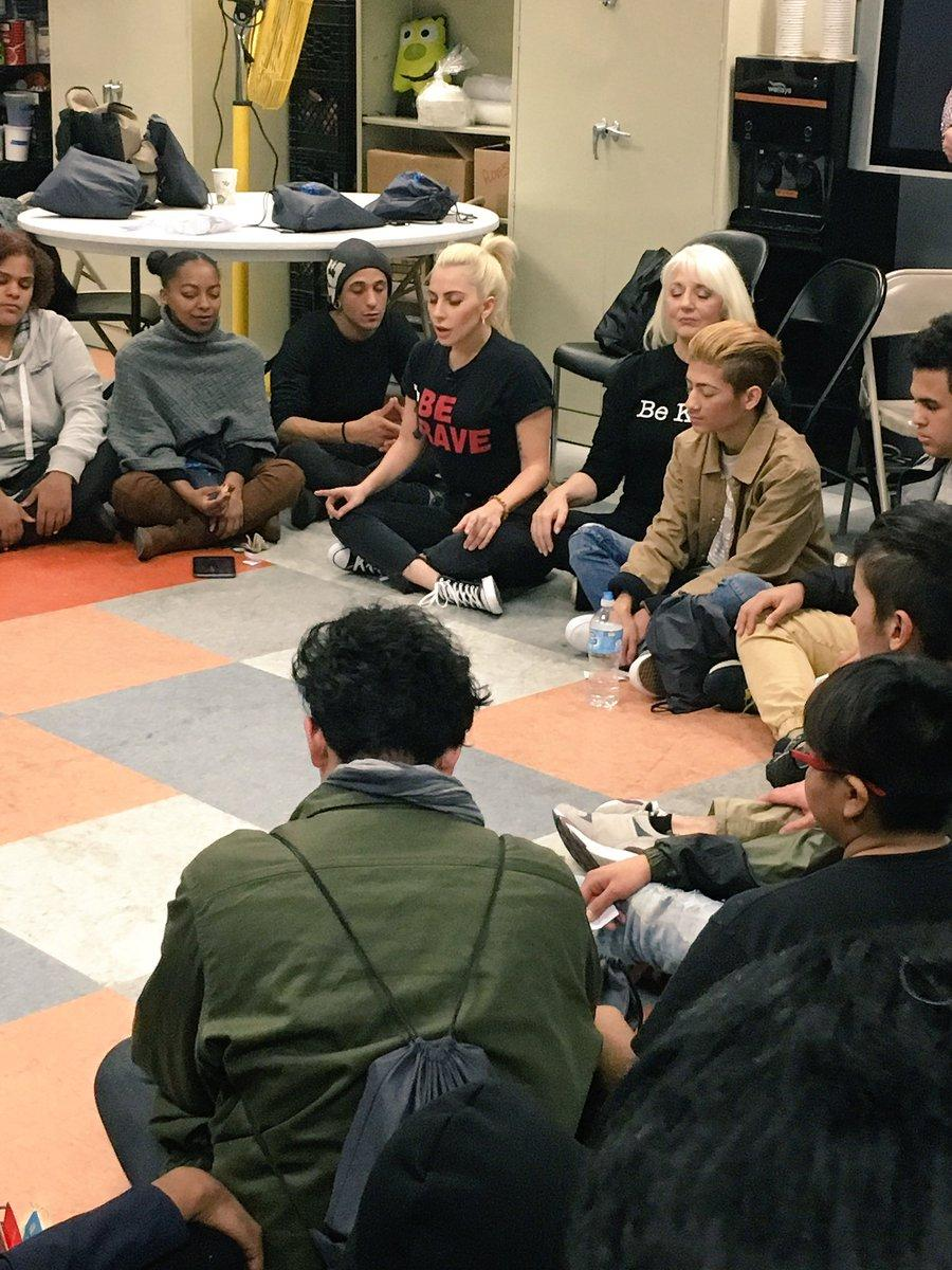 Lady Gaga with teens at a homeless shelter for LGBT youth in New York City.  Credit: Twitter