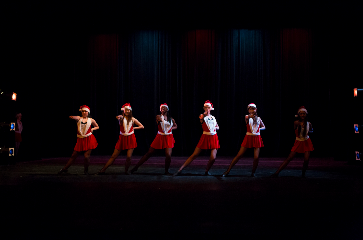 Gabby (far left), Destiny (third from left), and Makenna (fourth from left) perform as Rockettes in the fall dance concert Contagion. Credit: Flickr.