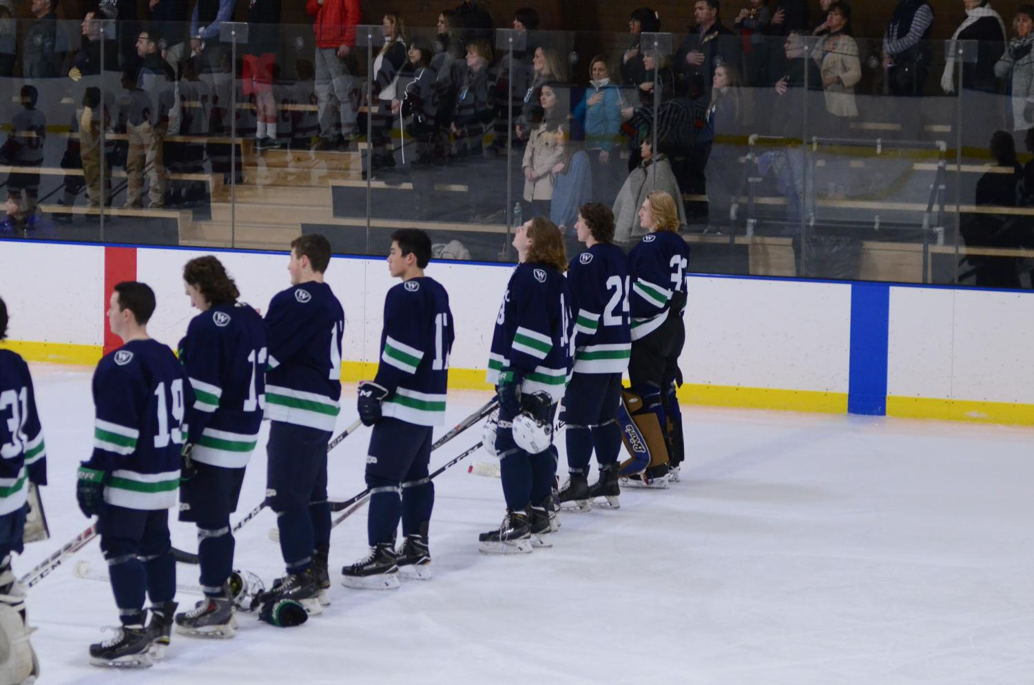 Hockey players line up during the National Anthem at Senior Night 2017 against Pomfret. Credit: Williston Flickr.