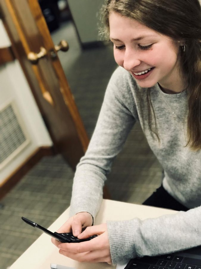 Sarah+enjoying+her+new+fliphone.+