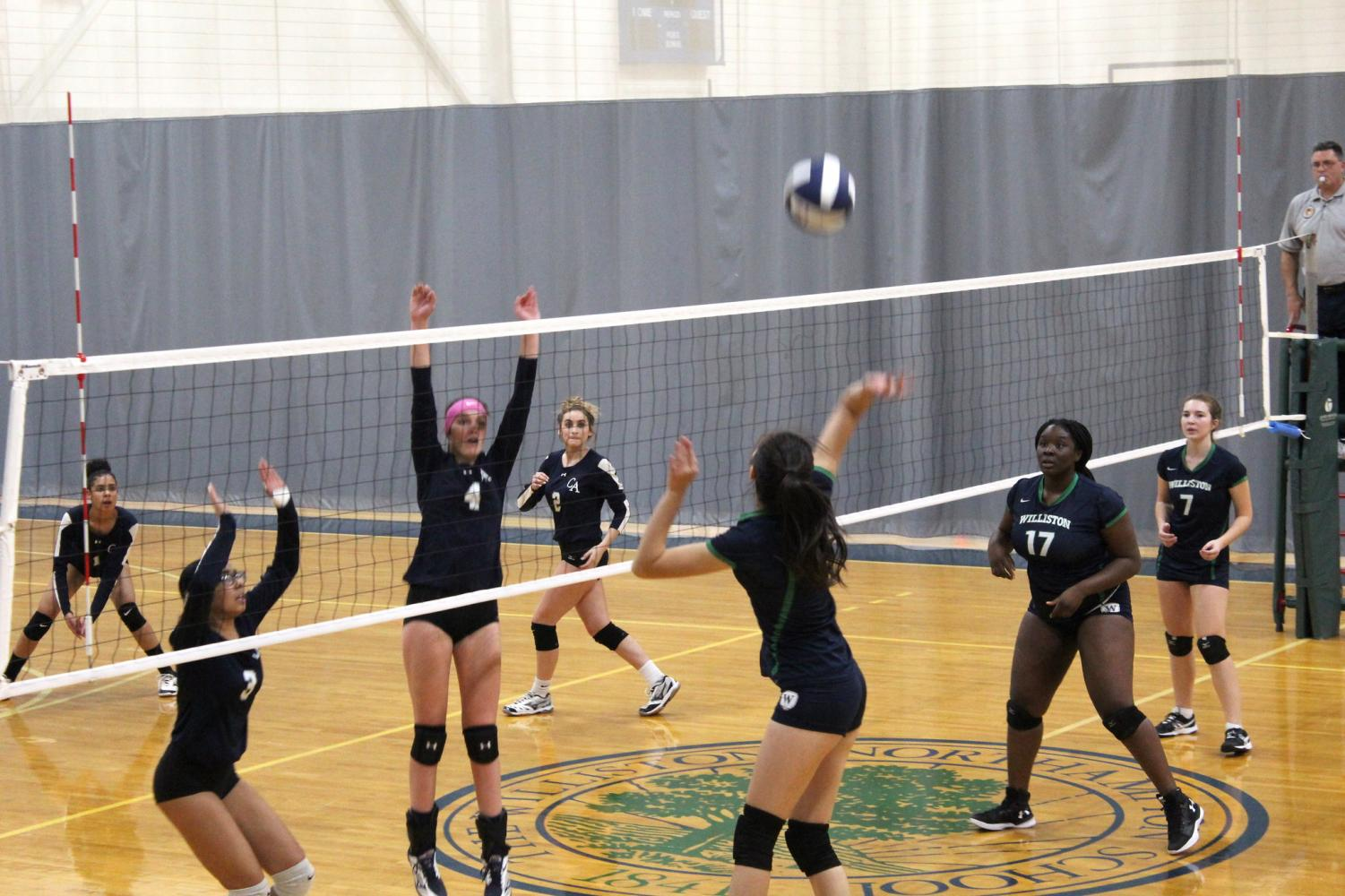 The volleyball team in a 2018 game against Cheshire.